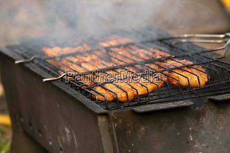 tasty meat fried in grile with