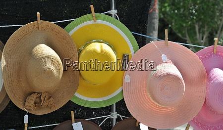 sun hats on a market