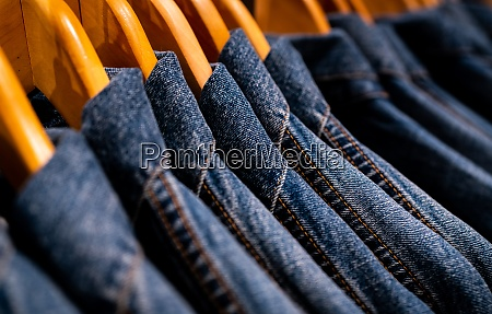 selective focus on jacket jeans hanging