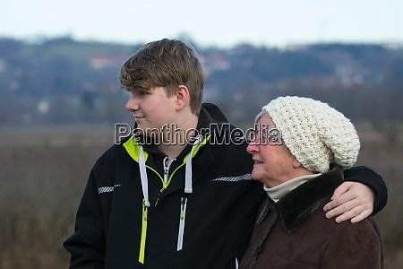 grandma with teenage grandson on winter