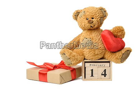 teddy bear and wooden calendar with