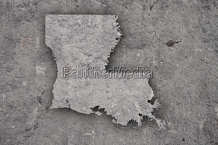 map of louisiana on weathered concrete