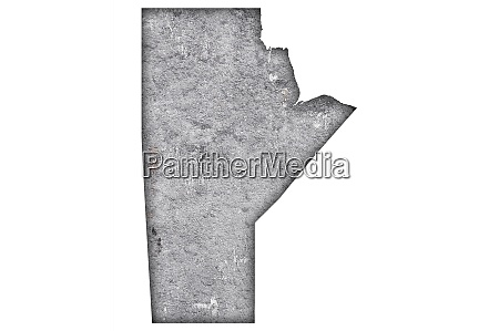 map of manitoba on weathered concrete