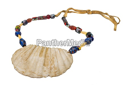 indian necklace with a large seashell