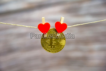 bitcoin hanging with red heart isolated