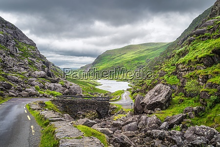 narrow winding road and stone bridge