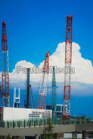 summer sky and thunderhead and crane