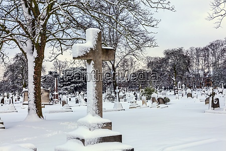 cemetery winter cityscape with snow