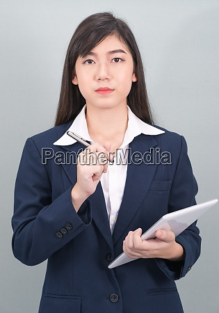 woman in suit using computer digital