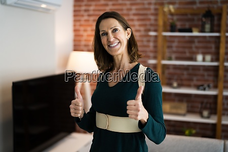 kinesiology physio tape on woman shoulder