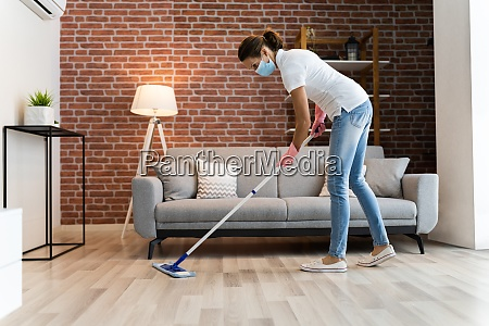 woman cleaning the hardwood floor with