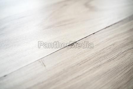 damaged old laminate flooring surface