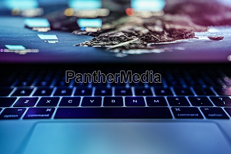 glowing blue laptop keyboard image