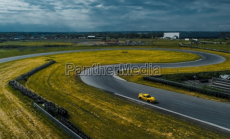 yellow car on the race track