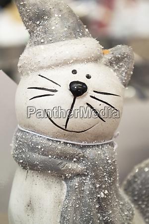 ceramic cat with a cute silver