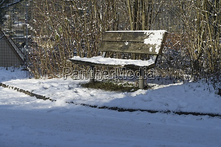 a park bench with a wooden