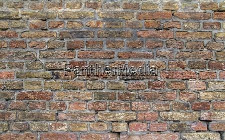 rundown brick wall
