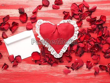 red fabric heart with a letter