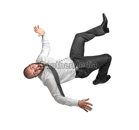 businessman falling scared expression