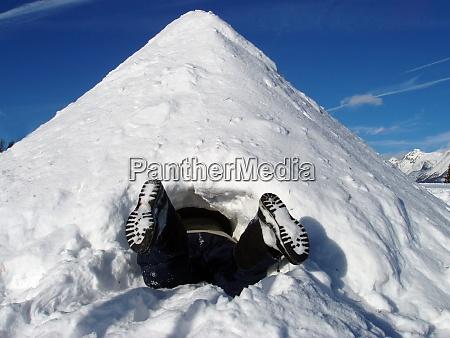 an igloo in winter snow