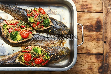 baked fish stuffed with vegetables