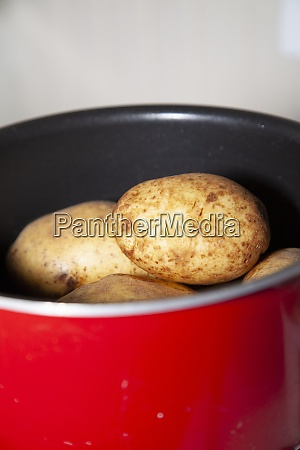 whole potatoes in a pan