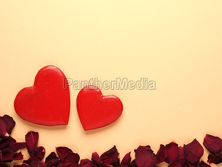 rustic wooden hearts with rose petals