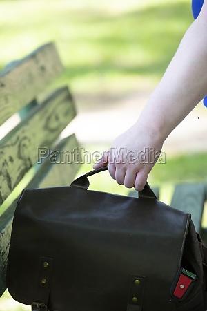 woman grabbing her bag
