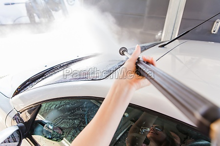 washing car with pressure washer at