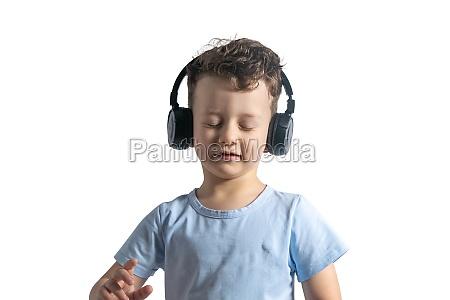 a beautiful european boy listens to