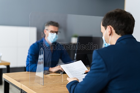 job interview in covid face mask