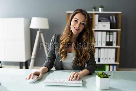 happy professional woman employee using computer