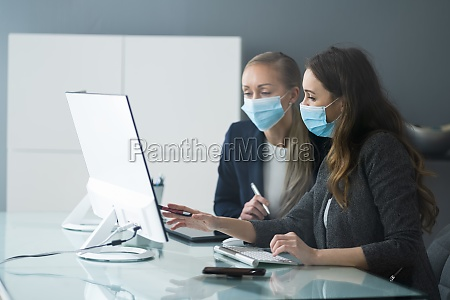 business meeting at computer desk