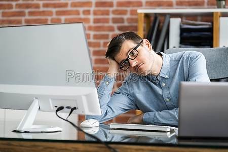 bored unhappy man watching in online