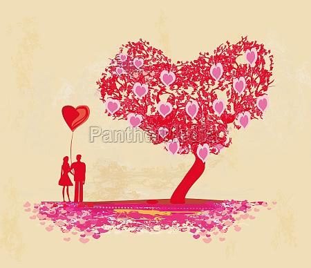romantic couple under a love tree