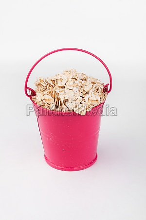 heap oat flakes grains in pink