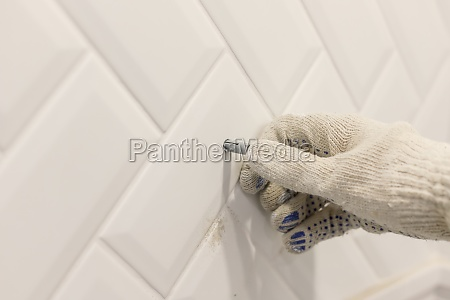workers hand in glove inserts wall