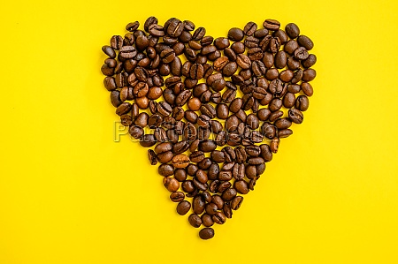 coffee bean heart isolated on yellow