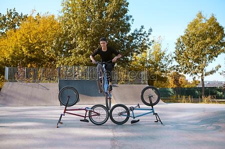 bmx bikers lifestyle training in skatepark