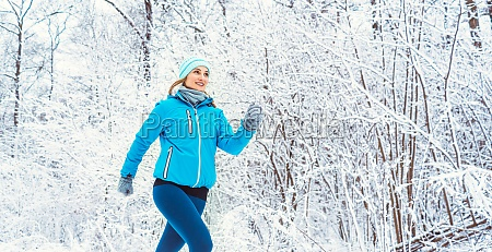 fit woman running in winter and