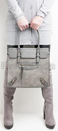 gray womens boots with a handbag