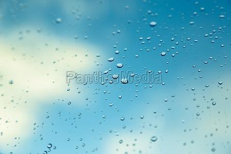 water drops on the window blue