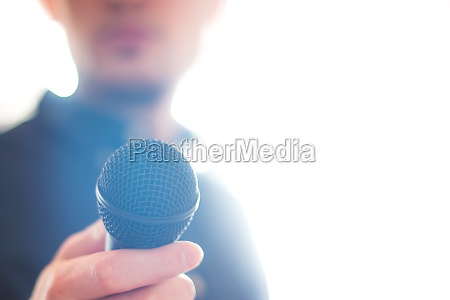 press officer is speaking into a