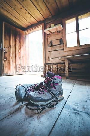 alpine boots on rustic wood floor