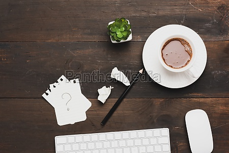 white wireless keyboard and cup of