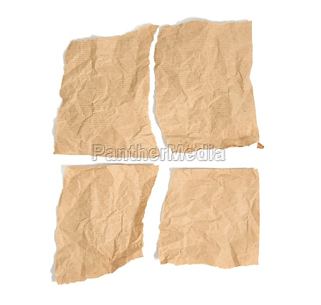 four torn pieces of brown kraft