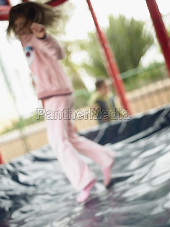 side profile of a girl jumping