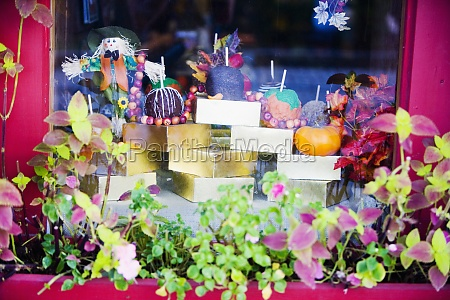 decorated candles in a window display
