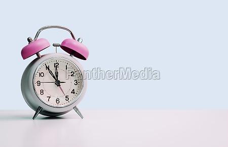 retro styled white alarm clock isolated