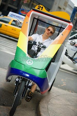 young man driving a rickshaw new